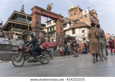 KATHMANDU, NEPAL - MARCH: People on Durbar Square where the historical centre of Kathmandu in Nepal. - stock photo