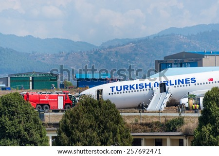 KATHMANDU, NEPAL - MARCH 4, 2015: Turkish Airlines flight THY726 crashed earlier in the morning at Tribhuvan International Airport apparently due to dense fog. No passengers were seriously hurt. - stock photo