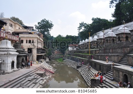 KATHMANDU, NEPAL - MAY 17: Cremation Vats along the holy Bagmati River at Pashupatinath Temple complex, May 17, 2011 in Kathmandu, Nepal. Bagmati pours into the sacred to all Hindus the Ganges river.
