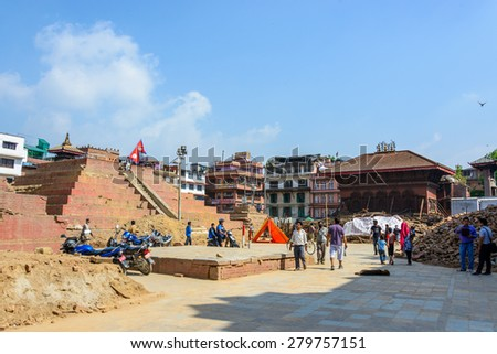 KATHMANDU, NEPAL - MAY 14, 2015: Durbar Square, a UNESCO World Heritage Site, is partially destroyed after two major earthquakes hit Nepal in the past weeks. - stock photo