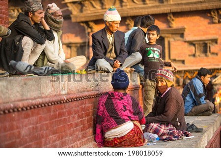 KATHMANDU, NEPAL - NOV 29, 2013: Unknown of local Nepalese people on the Old Durbar Square with pagodas. Largest city of Nepal, its cultural center, a population of over 1 mill people.