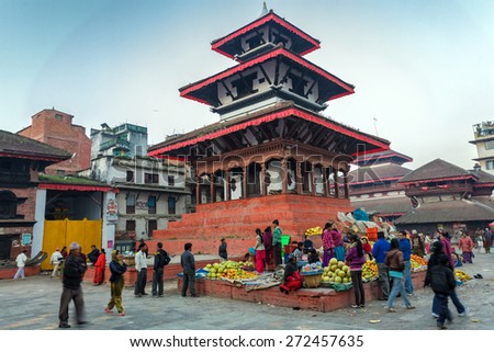 KATHMANDU,NEPAL,NOVEMBER 04,2010: Morning market activity in the Historical Patan Durbar square in Kathmandu, Nepal.  - stock photo