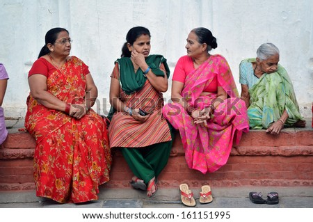 KATHMANDU,NEPAL - OCT 11: Citizens of Kathmandu relaxing and enjoying the holidays in Durbar Square, during the Hindu Dashain festival. On October 11, 2013 in Kathmandu, Nepal