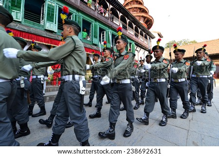 KATHMANDU, NEPAL - OCT 11: Nepalese soldiers marching in the inner courtyard of the Royal Palace waiting for the Primes Minister during the Dasain Festivity. On Oct 11, 2013 in Kathmandu, Nepal  - stock photo