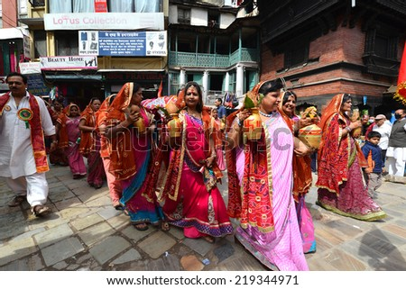 KATHMANDU, NEPAL - OCTOBER 11: Crowd of Hindu people celebrating the first day of the Dasain festival on the streets of Kathmandu. On October 11, 2013 in Kathmandu, Nepal - stock photo