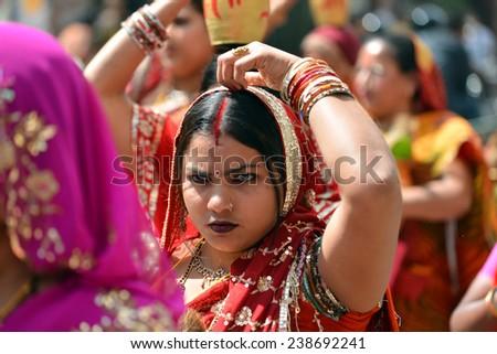 KATHMANDU, NEPAL - OCTOBER 11: Crowd of Hindu people celebrating the first day of the Dasain festival on the streets of Kathmandu. On October 11, 2013 in Kathmandu, Nepal  - stock photo