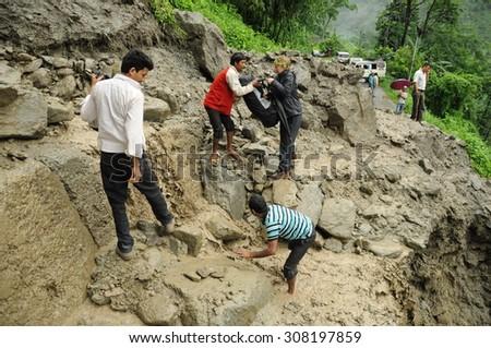 KATHMANDU, NEPAL - SEPTEMBER 17: Huge landslide destroyed the most important road in Nepal - Kathmandu to Pohkara on September 17, 2014. Public traffic has collapsed, hundred people got stuck. Nepal - stock photo