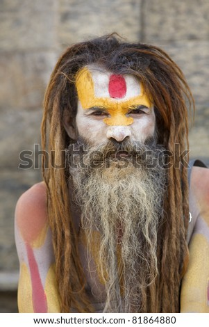 KATHMANDU-OCT 7:  A Sadhu at Pashupatinath Temple in Kathmandu, Nepal on October 7, 2008. The two primary sectarian divisions in sadhu community are Shaiva sadhus and Vaishnava sadhus. - stock photo