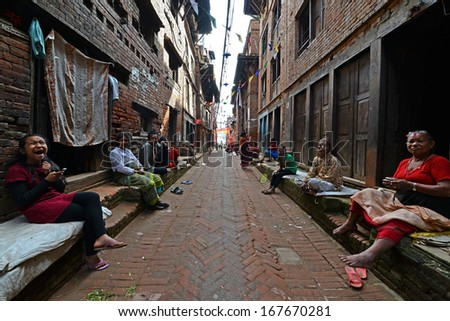 KATHMANDU - OCT 10: People of Kathmandu suburbs trying to survive in the daily life. They live in narrow streets in small apartments without water and electricity. On Oct 10, 2013 in Kathmandu, Nepal - stock photo