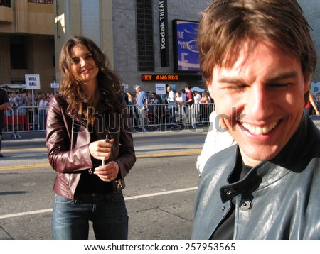 "Katie Holmes and Tom Cruise at the ""War of the Worlds"" Los Angeles Fan Screening held at the Grauman's Chinese Theater in Hollywood on June 27 2005. - stock photo"