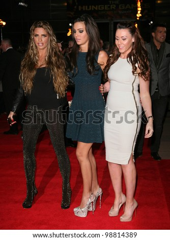 Katie Price, Ellie Jenas and Michelle Heaton arriving at the European Premiere of 'The Hunger Games' at the O2 Arena, London. 14/03/2012 Picture by: Alexandra Glen / Featureflash - stock photo