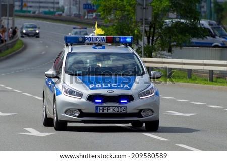 KATOWICE, POLAND - AUGUST 06, 2014: Kia Seed polish police car at the city street. - stock photo