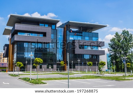 KATOWICE, POLAND - JUNE 07, 2014: Modern office building, seat of Polski Koks - one of the leading coke exporters in the world, part of JSW Group. Black parts of the building refer to coke and coal.