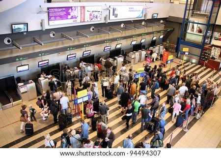 KATOWICE, POLAND - SEPTEMBER 1: Travelers wait for check-in on September 1, 2009 at Katowice Airport, Poland. With 2.366m passengers in 2010 it was the 3rd busiest airport in Poland. - stock photo