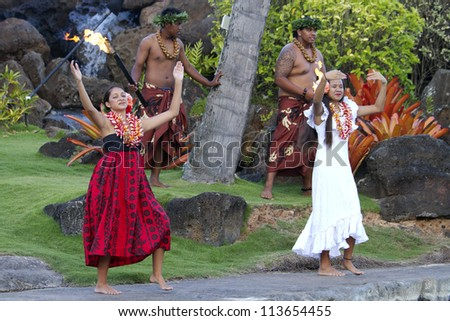 KAUAI, HAWAII - AUGUST 7: Aloha festival. Attractive young people in traditional dress perform Hawaiian dance on August 7, 2012 in Lihue, Kauai. - stock photo