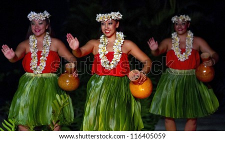 KAUAI, HAWAII - AUGUST 11: Aloha festival. Attractive young women in traditional dress perform Hawaiian dance on August 11, 2012 in Lihue, Kauai.