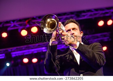 "KAUNAS, LITHUANIA - APRIL 25, 2015: German jazz musician Till Broner nominated for a Grammy Award in 2008 and 2009 performs at the stage of ""Kaunas Jazz"" festival.  - stock photo"