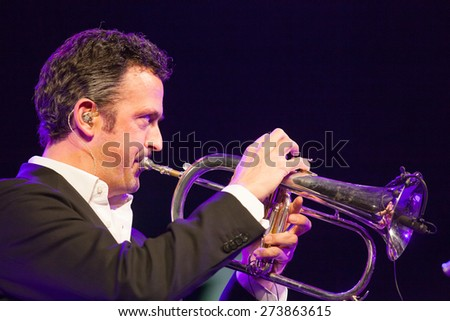 "KAUNAS, LITHUANIA - APRIL 25, 2015: German jazz musician Till Broner nominated for a Grammy Award in 2008 and 2009 performs at the stage of ""Kaunas Jazz"" festival."