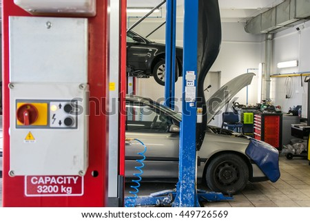 KAUNAS, LITHUANIA - JULY 1, 2016: Car service garage. Broken car. Car need to be repaired. Car on the lift - stock photo