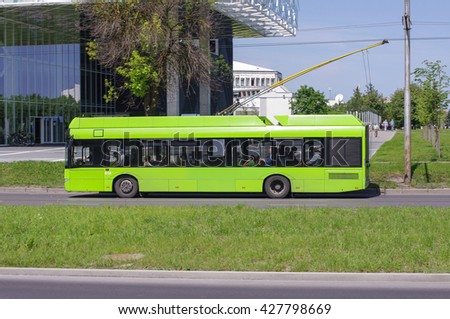 KAUNAS, LITHUANIA - MAY 27, 2016: Green trolley bus on the go. Photo taken on May 27, 2016 in Kaunas, Lithuania.