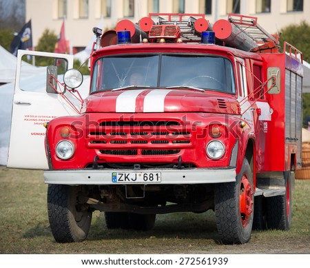 KAUNAS - MAR 26: Fire truck ZIL 130 on Mar. 26, 2015 in Kaunas, Lithuania. A firefighter (also known as a fireman) is a rescuer extensively trained in firefighting. - stock photo