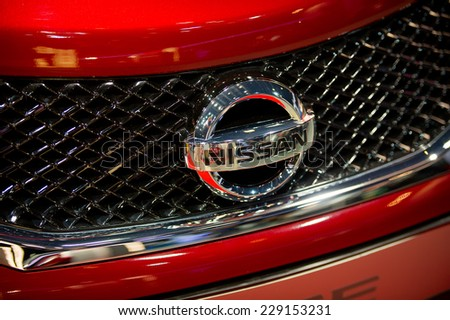 KAUNAS - SEP 19: Close-up of Nissan logo on Sep. 19, 2014 in Kaunas, Lithuania. Nissan Motor Corporation is a Japanese multinational automobile manufacturer headquartered in Nishi-ku, Yokohama, Japan - stock photo