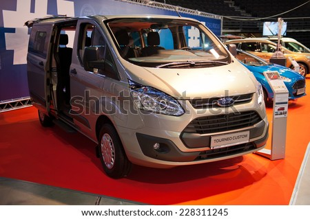 KAUNAS-SEP 19: Ford Transit/Tourneo Custom van on display on Sep. 19, 2014 in Kaunas, Lithuania. The Transit/Tourneo Custom is a mid-size van produced by Ford Motor Company.