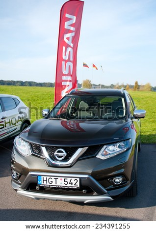 KAUNAS - SEP 19: Nissan X-Trail Crossover SUV on Sep. 19, 2014 in Kaunas, Lithuania. The Nissan X-Trail is a compact or mid-size crossover SUV produced by the Japanese automaker Nissan since 2001.
