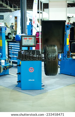 KAUNAS-SEP 19: Taida STD-412 Wheel Balancer on Sep. 19, 2014 in Kaunas, Lithuania. TaiDa is an EJV Sino-Italian carried out between the Chinese firm Hong Da Group and the Italian company TAG S.R.L. - stock photo