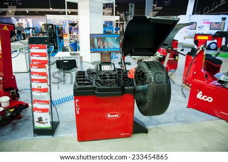 KAUNAS - SEP 19: Teco 68 Wheel Balancer on Sep. 19, 2014 in Kaunas, Lithuania. The Teco 68 is the second of the main workhorse wheel balancers. This wheel balancer is designed for busy tyre garages. - stock photo