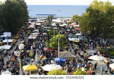 KAVALA, EASTMACEDONIA, GREECE - SEPTEMBER 22: Unidentified people on weekly street market for fruits and vegetables, on September 22, 2012 in Kavala, Greece