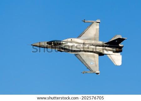 KAVALA, GREECE- JUNE 21, 2014: HAF F-16 flying in the sky during the Kavala Airshow 2014, in Kavala, Greece. - stock photo