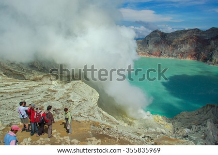 KAWAH IJEN, INDONESIA - OCT 16 : A number of tourists looking down to Ijen Crater or Kawah Ijen. Kawah Ijen is another volcanic tourism attraction in East Java, Indonesia  on OCT 16, 2010 - stock photo