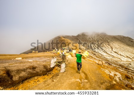 KAWAH IJEN, INDONESIA on June 18,2016. Miners are extracting gaseous sulfur going out in the mine of the crater. - stock photo