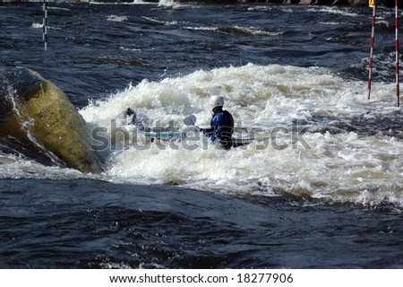 Kayak at competitions on a rowing slalom - stock photo