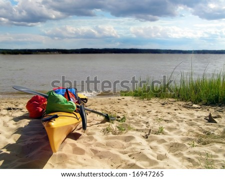 Kayak beached at Lions Camp Merrick on the Potomac River, MD. - stock photo
