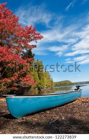 Kayak, Boat during sunny day at a lake with blue sky - stock photo