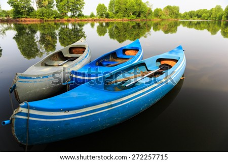 Kayak boats in calm lake - stock photo