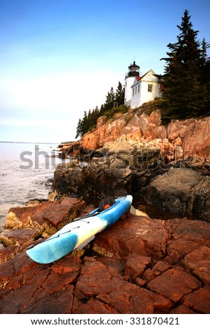 kayak in acadia national park in Maine next to a lighthouse - stock photo