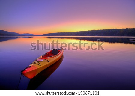Kayak on Lake at Sunrise - stock photo