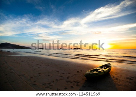 Kayak on the beach at sunset. Thailand. - stock photo