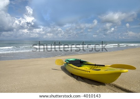 kayak on the beach with sky and Ocean