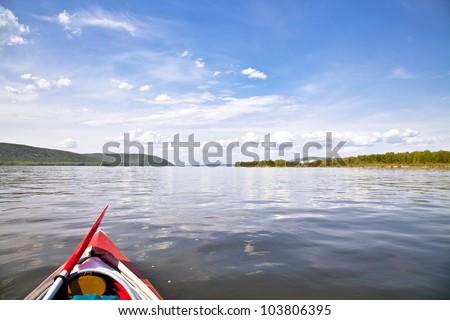 kayak on the water. Against the background of Zhiguli Mountains. The Volga River near Samara. - stock photo