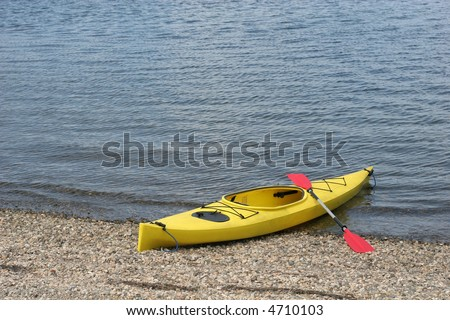 kayak sitting on beach