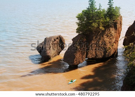Kayaker at Hopewell Rocks in the Bay of Fundy, New Brunswick, Canada in the muddy water at high tide