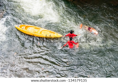 Kayaker emerging from underwater after a high jump.Thailand - stock photo