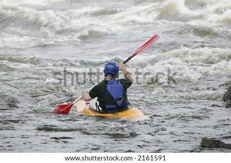 Kayaker in action - stock photo