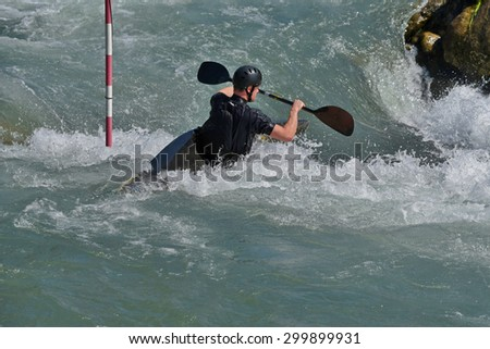 Kayaker is moving across whitewater rapids. - stock photo