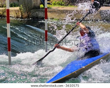 kayaker maneuvering in extreme whitewater - stock photo