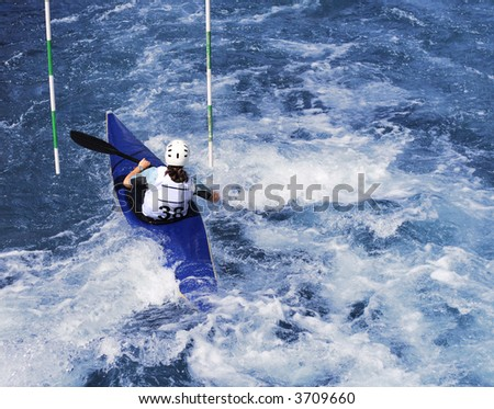 kayaker manoeuvring in calm blue river - stock photo